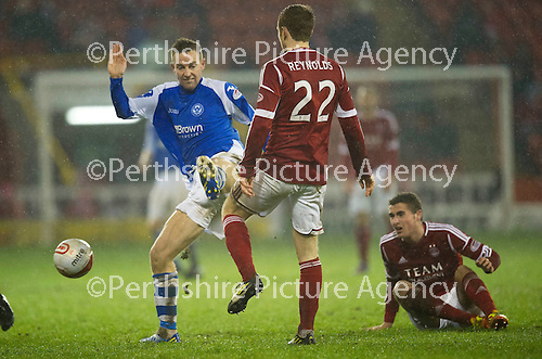 Aberdeen v St Johnstone..22.12.12      SPL.Steven MacLean charges down Mark Reynolds.Picture by Graeme Hart..Copyright Perthshire Picture Agency.Tel: 01738 623350  Mobile: 07990 594431