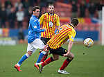 Partick Thistle v St Johnstone.....14.03.15<br /> Danny Swanson is blocked by Callum Booth<br /> Picture by Graeme Hart.<br /> Copyright Perthshire Picture Agency<br /> Tel: 01738 623350  Mobile: 07990 594431