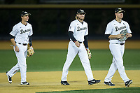 Bruce Steel (17), Johnny Aiello (2), and Gavin Sheets (24) walk off the field after their win over the Kent State Golden Flashes in game two of a double-header at David F. Couch Ballpark on March 4, 2017 in Winston-Salem, North Carolina.  The Demon Deacons defeated the Golden Flashes 5-0.  (Brian Westerholt/Four Seam Images)