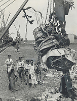 Smashed jet engine, from the Air Canada DC-8 airliner that plunged to each Sunday north of Toronto International Airport, is hoisted by a crane yesterday and moved away from the crash site to facilitate the search for bodies. The engine was so badly damaged it started to break apart as it was lifted. Many of the bodies of the 108 dead are so badly mutilated that they may never be idenfitied.<br /> <br /> Photo : Boris Spremo - Toronto Star archives - AQP