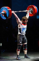 10 MAY 2014 - COVENTRY, GBR - Jack Oliver from the Paul Furness School of Weightlifting completes his lift to break the British clean and jerk record of 171kg in the men's 77kg category with a lift of 172kg at the British 2014 Senior Weightlifting Championships and final 2014 Commonwealth Games qualifying event round at the Ricoh Arena in Coventry, Great Britain. Oliver's combined total for the event of 312kg, 32kg over the qualifying standard, makes him eligible for selection for the England team for the Commonwealth Games in Glasgow (PHOTO COPYRIGHT © 2014 NIGEL FARROW, ALL RIGHTS RESERVED)