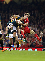 Pictured: Liam Williams of Wales (R) clashing mid-air against Cornal Hendricks of South Africa (L) Saturday 29 November 2014<br />