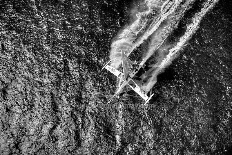 Aerial photo shoot of l'HydroptËre DCNS, Alain ThÈbault and his crew (Yves Parlier, Jean le Cam, Jacques Vincent, Luc Alphand)  during the first series of trials on the Med before trying to beat the Pacific crossing record between Los Angeles and Honolulu next summer. La Ciotat in the Bouches-du-RhÙne, Provence-Alpes-CÙte d'Azur, France. ( http://hydroptere.com/news/466/98/Cordee-de-legende/ )