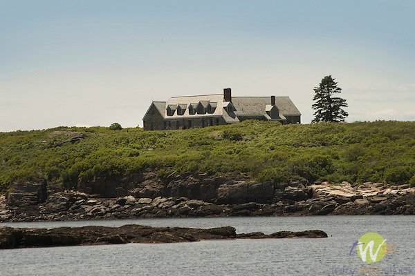 Boothbay Harbor. Fisherman's Island stone mansion. 5,000-square-foot stone home complete with seven bedrooms, spa amenities, a dining room table that seats 12 people, a billiard table and a chef to accommodate meals.