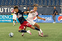 """FOXBOROUGH, MA - SEPTEMBER 04: Adolfo """"Fito"""" Ovalle #5 Forward Madison FC tackles Nicolas Firmino #29 of New England Revolution II during a game between Forward Madison FC and New England Revolution II at Gillette Stadium on September 04, 2020 in Foxborough, Massachusetts."""