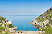 The windmill on the beach Gialia of Alonissos island, Greece