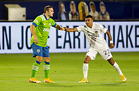 CARSON, CA - SEPTEMBER 27: Jordan Morris #13 of the Seattle Sounders and Julian Araujo #22 of the Los Angeles Galaxy celebrates shake hands during a game between Seattle Sounders FC and Los Angeles Galaxy at Dignity Heath Sports Park on September 27, 2020 in Carson, California.