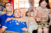 Italy fans Laura Cordora and Giorgio Marraffa react to a shot on goal while fellow Italy fan Gwendaline Mazzara eats a panini during their team's World Cup match against the United States on June 17, 2006 at L'Angolo, a restaurant in New York City.<br /> <br /> The World Cup, held every four years in different locales, is the world's pre-eminent sports tournament in the world's most popular sport, soccer (or football, as most of the world calls it).  Qualification for the World Cup is open to any country with a national team accredited by FIFA, world soccer's governing body. The first World Cup, organized by FIFA in response to the popularity of the first Olympic Games' soccer tournaments, was held in 1930 in Uruguay and was participated in by 13 nations.    <br /> <br /> As of 2010 there are 208 such teams.  The final field of the World Cup is narrowed down to 32 national teams in the three years preceding the tournament, with each region of the world allotted a specific number of spots.  <br /> <br /> The World Cup is the most widely regularly watched event in the world, with soccer teams being a source of national pride.  In most nations, the whole country is at a standstill when their team is playing in the tournament, everyone's eyes glued to their televisions or their ears to the radio, to see if their team will prevail.  While the United States in general is a conspicuous exception to the grip of World Cup fever there is one city that is a rather large exception to that rule.  In New York City, the most diverse city in a nation of immigrants, the melting pot that is America is on full display as fans of all nations gather in all possible venues to watch their teams and celebrate where they have come from.
