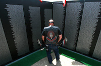 Mil.Wall.2.0415.jl.jpg/photo Jamie Scott Lytle/Kenneth Bedley of bellflower looks at the memorial wall on display at the El Corazon Seinor Center in Oceanside Thursday
