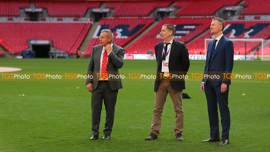 Brentford's Chief Executive Officer, Jon Varney, Brentford Owner, Matthew Benham and Brentford's Co Director of Football, Phil Giles look on as the players celebrate promotion to the Premier League with the fans during Brentford vs Swansea City, Sky Bet EFL Championship Play-Off Final Football at Wembley Stadium on 29th May 2021