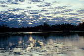 Pantanal, Mato Grosso, Brazil. Late afternoon with the dappled pattern of the sun and clouds on the water.
