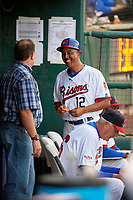 Former MLB player Mark Ryal (left) talks with Buffalo Bisons manager Bob Meacham (12) during a game against the Syracuse Chiefs on June 30, 2017 at Coca-Cola Field in Buffalo, New York.  Syracuse defeated Buffalo 8-1.  (Mike Janes/Four Seam Images)