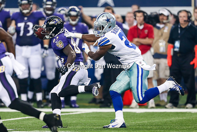 Baltimore Ravens wide receiver Deonte Thompson (83) and Dallas Cowboys running back Joseph Randle (21) in action during the pre-season game between the Baltimore Ravens and the Dallas Cowboys at the AT & T stadium in Arlington, Texas. The Ravens lead Dallas 24 to 10 at half time.