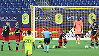 NASHVILLE, TN - SEPTEMBER 23: Referee Tori Penso calls a foul against Russell Canouse #4 of DC United during a game between D.C. United and Nashville SC at Nissan Stadium on September 23, 2020 in Nashville, Tennessee.
