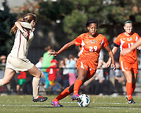 University of Miami forward Blake Stockton (29) brings the ball forward. .After two overtime periods, Boston College (gold) tied University of Miami (orange), 0-0, at Newton Campus Field, October 21, 2012.