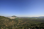 Israel, Lower Galilee. A view of Jezreel valley from Bet Keshet Scenic Road, Mount Deborah is on the left Mount Tabor in the distance