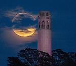 """April's full moon is the """"pink"""" moon, and it's a supermoon, too. Caught in the night sky over Coit Tower, San Francisco on Monday 4/26/21."""