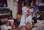 Mount Zion Spiritual Baptist church North London UK. An upstairs room in the church is used a a nursery and storage space for clothes etc that will go to charity. 1990s