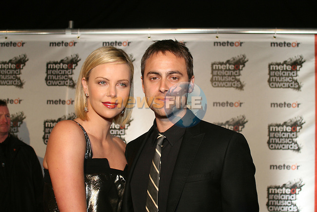 Charleze Theron and Stuart Townsend at the 2008 Meteor Music Awards at the RDS, Simmonscourt...Photo NEWSFILE/Jenny Matthews.(Photo credit should read Jenny Matthews/NEWSFILE)....This Picture has been sent you under the condtions enclosed by:.Newsfile Ltd..The Studio,.Millmount Abbey,.Drogheda,.Co Meath..Ireland..Tel: +353(0)41-9871240.Fax: +353(0)41-9871260.GSM: +353(0)86-2500958.email: pictures@newsfile.ie.www.newsfile.ie.FTP: 193.120.102.198.