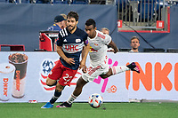 FOXBOROUGH, MA - MAY 22: Carles Gil #22 of New England Revolution turns towards the New York Red Bulls goal during a game between New York Red Bulls and New England Revolution at Gillette Stadium on May 22, 2021 in Foxborough, Massachusetts.