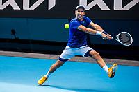 8th February 2021, Melbourne, Victoria, Australia;  Mikhail Kukushkin of Kazakhstan returns the ball during round 1 of the 2021 Australian Open on February 8 2020