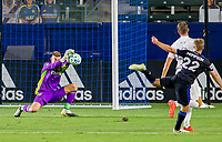 CARSON, CA - OCTOBER 14: Jonathan Klinsmann #33 GK of Los Angeles Galaxy make a save during a game between San Jose Earthquakes and Los Angeles Galaxy at Dignity Heath Sports Park on October 14, 2020 in Carson, California.