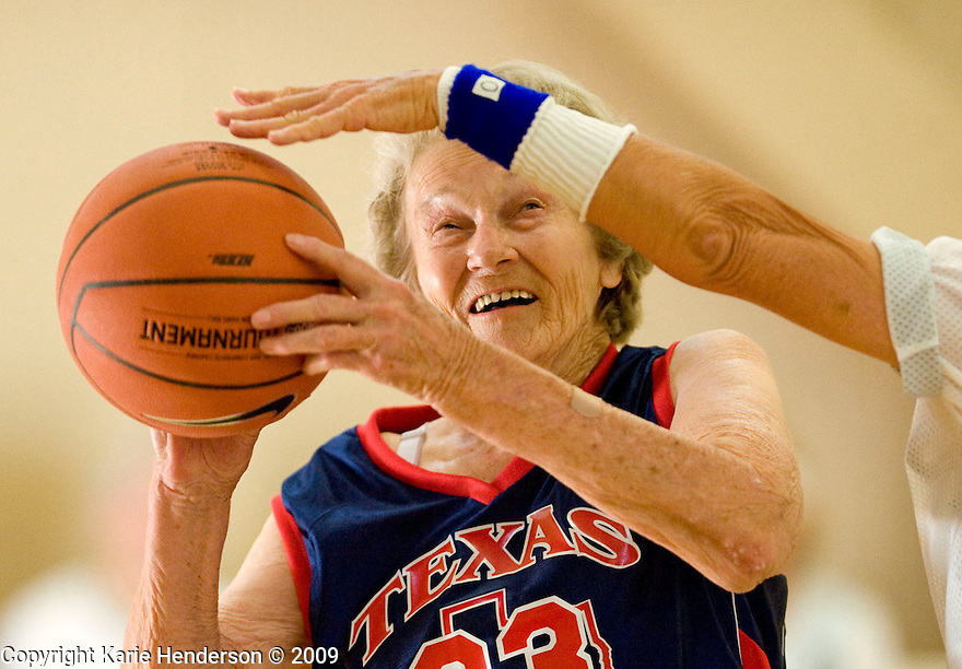 Nellene Pitman, 83, left, of the Texas Challenge women's 80+ Basketball team takes a shot as Jackie Ives, 79, right, of the Splash attempts to block her. During the Senior Games 2009, at Stanford University's Ford Center, in Palo Alto, Calif., on Friday, August 07, 2009.