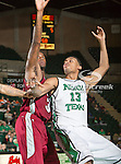 North Texas Mean Green forward Tony Mitchell (13) and Troy Trojans forward Ray Chambers (34) in action during the game between the Troy Trojans and the University of North Texas Mean Green at the North Texas Coliseum,the Super Pit, in Denton, Texas. UNT defeats Troy 87 to 65.....