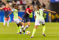 REIMS, FRANCE - JUNE 08: Ngozi  Okobi #13 tries to stop Isabell Herlovsen #9 as she dribbles up to Ngozi Ebere #4 during a game between Norway and Nigeria at Stade Auguste-Delaune on June 8, 2019 in Reims, France.