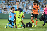 20th February 2021; Jubilee Stadium, Sydney, New South Wales, Australia; A League Football, Sydney FC versus Brisbane Roar; Ryan McGowan of Sydney receives treatment after a head injury during a collision with Jamie Young of Brisbane Roar