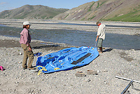 Georgia and Jonathan Bennett deflate their raft after completing their float trip down the Kongakut River, in Alaska's Arctic National Wildlife Refuge.