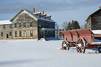 An early winter scene of the old hotel and a horse-drawn wagon. Fayette State Park, Garden Peninsula.