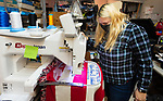 NAUGATUCK, CT-011221JS03-Loren Vorrase, owner of Team Images in Naugatuck, works on embroidering a memorial blanket Tuesday in memory of United States Capitol Police Officer Brian D. Sicknick who died on January 6, at the U.S. Capitol in Washington, D.C. The blanket will be presented to his family by members of the Federal Law Enforcement Officers Association. <br /> Jim Shannon Republican-American