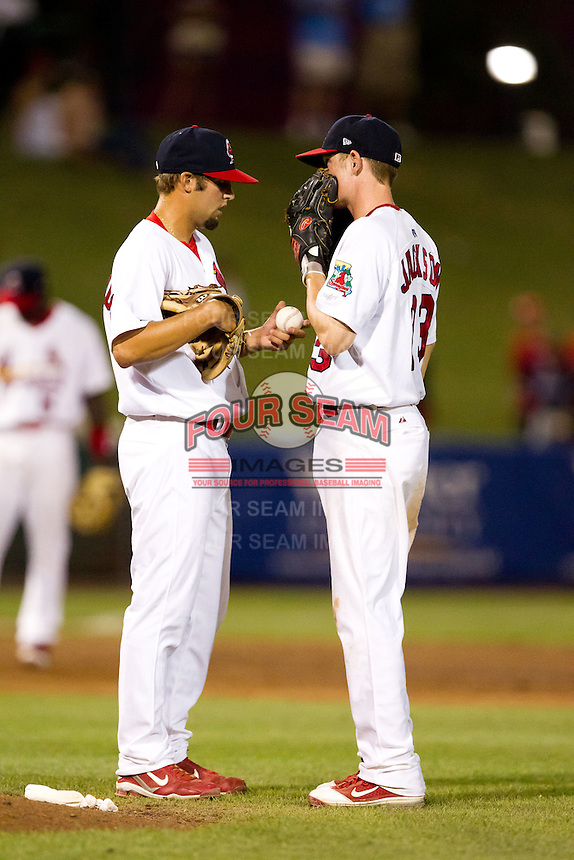 Nick Greenwood (32) of the Springfield Cardinals talks with Ryan Jackson (23) on the mound during a game against the Northwest Arkansas Naturals at Hammons Field on July 31, 2011 in Springfield, Missouri. Northwest Arkansas defeated Springfield 9-1. (David Welker / Four Seam Images)