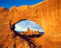USA, Utah, Arches National Park. Window Rock framing a view of Turret Rock