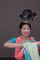 Beautiful Asian woman wearing blue traditional dress,  Dragon Fest 2015, Chinatown, Seattle, Washington State, WA, America, USA.