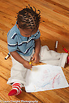 17 month old toddler boy scribbling with marker on paper