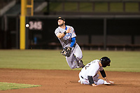 Mesa Solar Sox second baseman David Bote (15), of the Chicago Cubs organization, evades the slide of Braxton Lee (12) during a game against the Salt River Rafters on October 17, 2017 at Salt River Fields at Talking Stick in Scottsdale, Arizona. The Solar Sox defeated the Rafters 8-5.(Zachary Lucy/Four Seam Images)