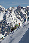 Mountain climbers on the Aiguille du Midi Ridge comng from the Vallee Blanche, seen from Aiguille du Midi, Chamonix-Mont-Blanc, France