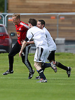 Pictured: Garry Monk pulled back by Chris Barney. Tuesday 06 May 2014<br /> Re: Members of the local press play football against Swansea City FC coaches and members of staff at the Club's training ground in Fairwood, south Wales.