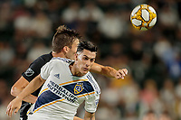 CARSON, CA - SEPTEMBER 15: Cristian Pavon #10 of the Los Angeles Galaxy heads a ball during a game between Sporting Kansas City and Los Angeles Galaxy at Dignity Health Sports Complex on September 15, 2019 in Carson, California.