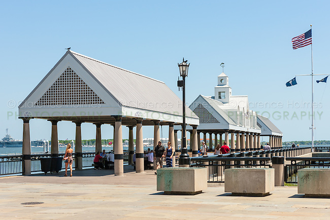 People walk on the pier and use the shelters in Waterfront Park on the Cooper River in Charleston, South Carolina.