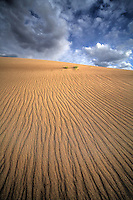 Verticle lines appear in the sand due to erosion at Great Sand Dunes National Park, Colorado