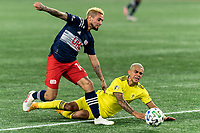 FOXBOROUGH, MA - OCTOBER 3: Diego Fagundez #14 of New England Revolution and Randall Leal #8 of Nashville SC battle for the ball during a game between Nashville SC and New England Revolution at Gillette Stadium on October 3, 2020 in Foxborough, Massachusetts.