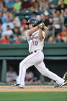 Catcher J.T. Watkins of the Greenville Drive bats in a game against the Asheville Tourists on Thursday, August 13, 2015, at Fluor Field at the West End in Greenville, South Carolina. Asheville won, 8-1. (Tom Priddy/Four Seam Images)