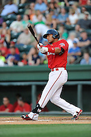 Second baseman Yoan Moncada (24) of the Greenville Drive bats in a game against the Charleston RiverDogs on Saturday, May 23, 2015, at Fluor Field at the West End in Greenville, South Carolina. The Cuban-born 19-year-old Red Sox signee has been ranked the No. 1 international prospect in baseball by Baseball America. Charleston won 5-4. (Tom Priddy/Four Seam Images)