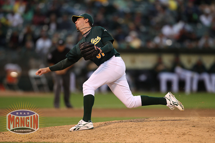 OAKLAND, CA - JULY 16:  Brad Ziegler of the Oakland Athletics pitches against the Los Angeles Angels of Anaheim during the game at the Oakland-Alameda County Coliseum on Saturday, July 16, 2011 in Oakland, California. Photo by Brad Mangin