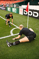 Referees stretch before the match. The women's national team of the United States defeated Canada 6-0 during an international friendly at Robert F. Kennedy Memorial Stadium in Washington, D. C., on May 10, 2008.