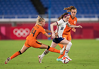 YOKOHAMA, JAPAN - JULY 30: Jackie Groenen #14 of the Netherlands defends Rose Lavelle #16 of the USWNT during a game between Netherlands and USWNT at International Stadium Yokohama on July 30, 2021 in Yokohama, Japan.