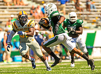 Sports Action Photography - Charlotte 49ers NCAA college football game between the University of North Carolina at Charlotte and Johnson C. Smith University  in Charlotte, N.C., Saturday, September 6, 2014.  Charlotte went on to beat JCSU 56-0 at Jerry Richardson Stadium in front 15,000 fans.<br />